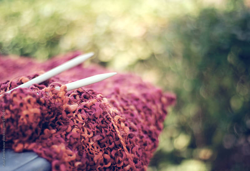 Closeup of a scarf in the process of being knitted. by Kaat Zoetekouw for Stocksy United