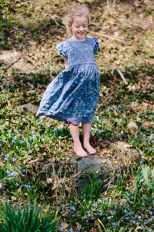 young girl in blue spring dress by Brian Powell for Stocksy United