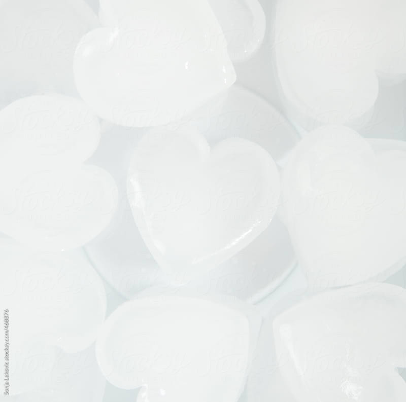 white ice hearts on white background by Sonja Lekovic for Stocksy United
