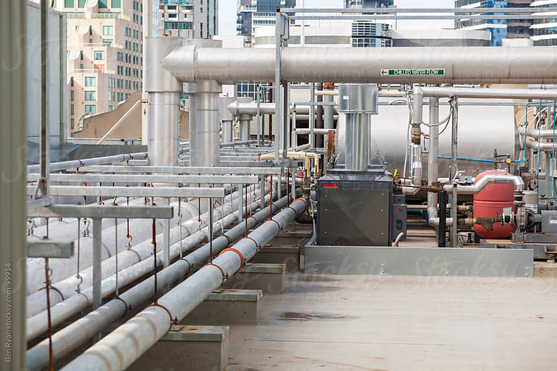 Network of industrial pipes on a rooftop by Ben Ryan for Stocksy United