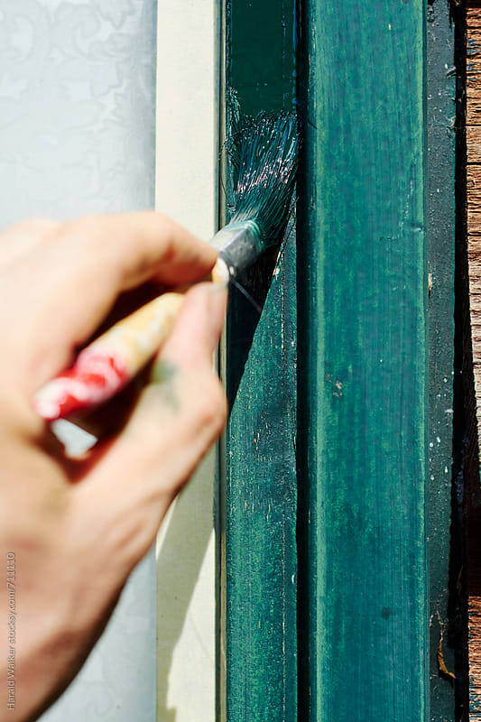 Painting a window frame by Harald Walker for Stocksy United