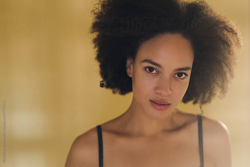 Portrait of a Beautiful Young Woman with Afro Hairstyle by Branislav Jovanović for Stocksy United
