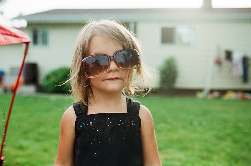 little girl with sunglasses by Maria Manco for Stocksy United
