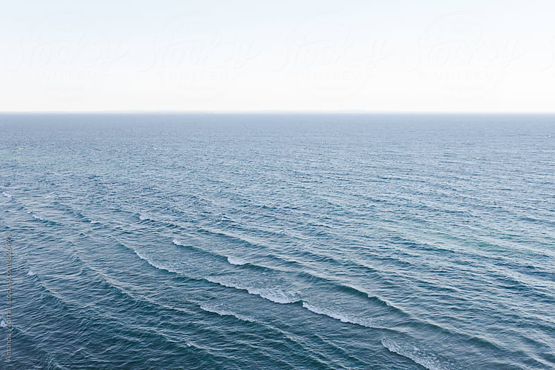 Minimalist image of waves over Lake Michigan by Amanda Worrall for Stocksy United