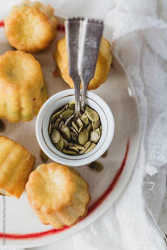 Homemade corn bread with pumpkin seeds  by Tatjana Ristanic for Stocksy United