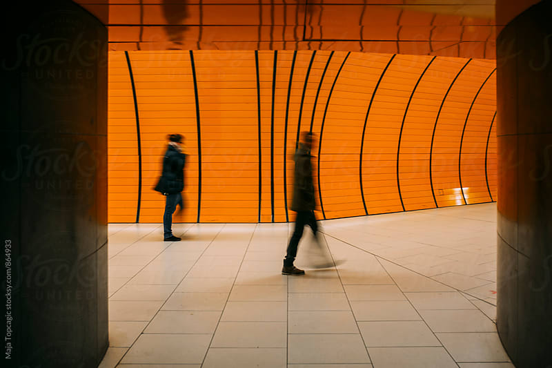 People walking in underground subway station by Maja Topcagic for Stocksy United