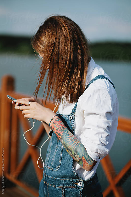 Woman listening music  by Sergey Filimonov for Stocksy United