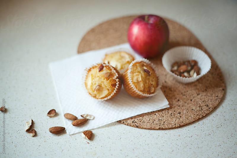 Almond and apple muffins by Claudia Guariglia for Stocksy United