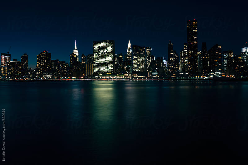 Midtown Manhattan skyline at night. New York City. by Kristin Duvall for Stocksy United