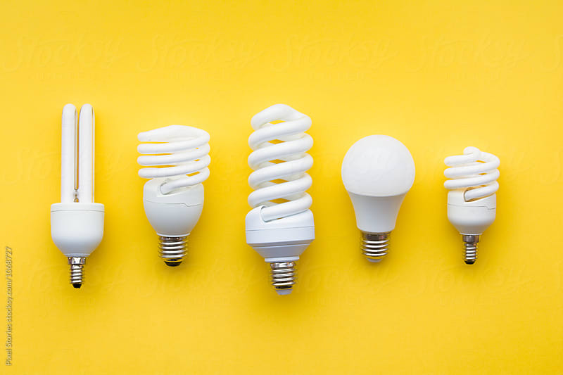Energy-saving lightbulbs on yellow background by Pixel Stories for Stocksy United