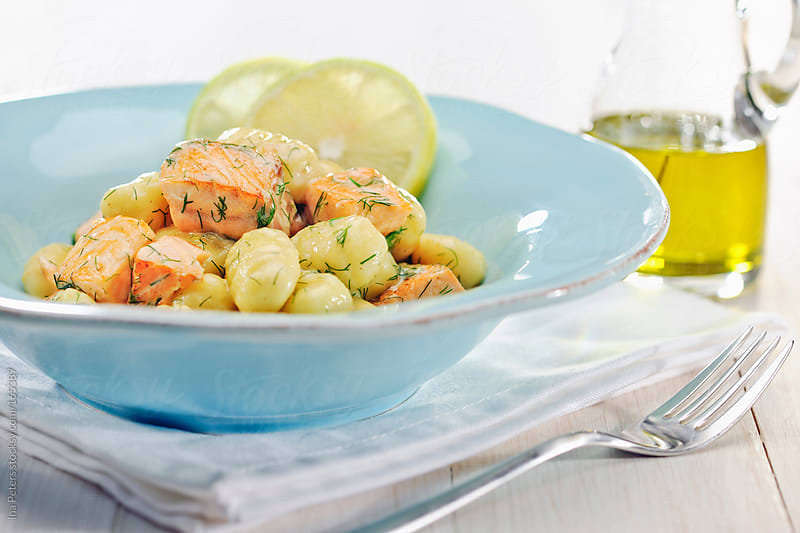 Food: Gnocchi with Salmon in a Wine Cream Dill sauce by Ina Peters for Stocksy United