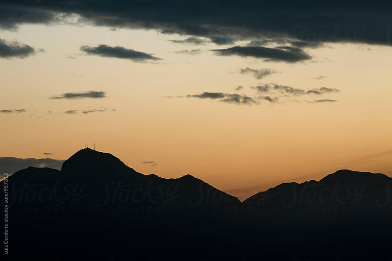 Telecommunications Tower and Mountain by Luis Cerdeira for Stocksy United