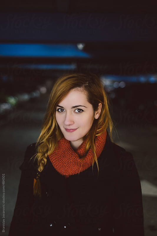 Portrait of a beautiful young woman at night time by Brkati Krokodil for Stocksy United