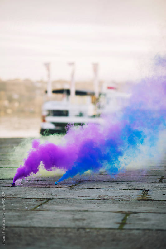 Purple and blue smoke bombs by Jovana Rikalo for Stocksy United