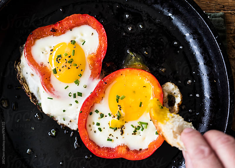 Fried Eggs in Red Pepper Rings by Jill Chen for Stocksy United