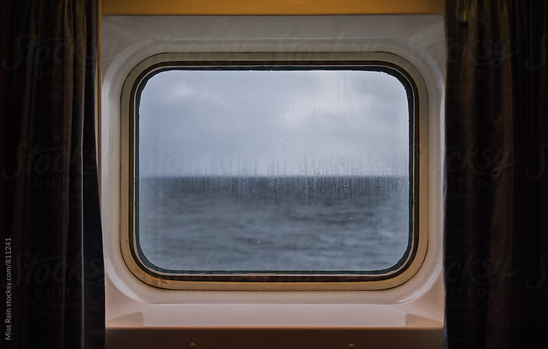 Through a steam ship window to see the sea by Miss Rein for Stocksy United