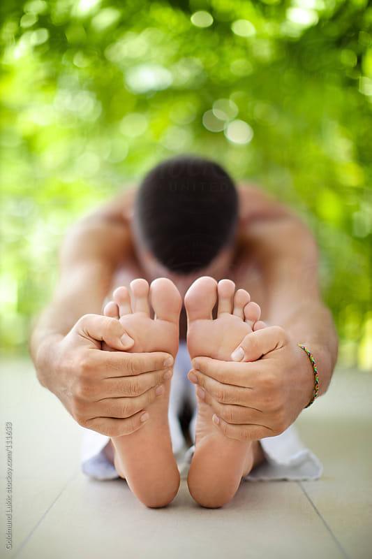 Man Doing Yoga by Goldmund Lukic for Stocksy United