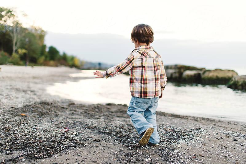 boy walking on beach by Maria Manco for Stocksy United