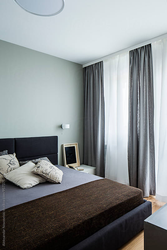 Contemporary bedroom by Aleksandar Novoselski for Stocksy United