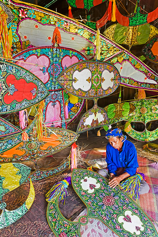 Asia, Malaysia, Kelantan State, Kota Bharu, Master Kite-maker constructing his world famous Kites by Gavin Hellier for Stocksy United