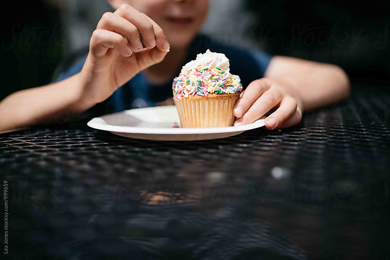 Child eating a cupcake by Léa Jones for Stocksy United
