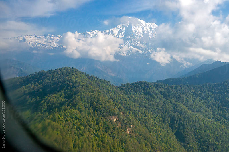 Himalayas from the airplane by Sasha Evory for Stocksy United