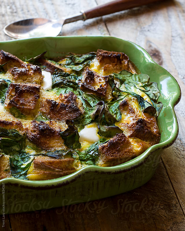 Close-up of delicious Spinach Strata in Green Baking Dish by Trent Lanz for Stocksy United