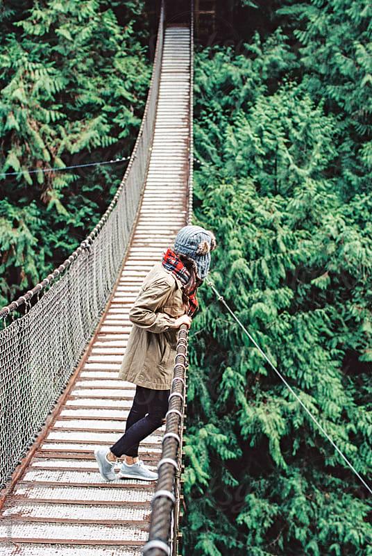 woman peering over bridge by Daniel Kim Photography for Stocksy United