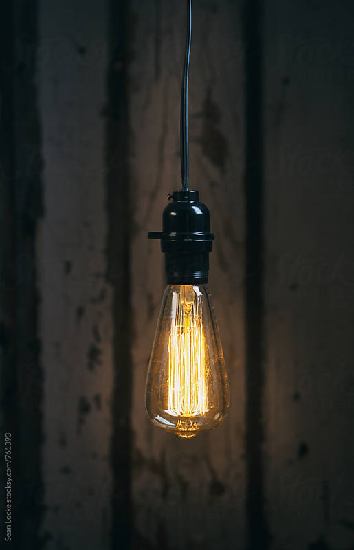 Light: Rustic Bulb Hangs In Front Of Wooden Background by Sean Locke for Stocksy United