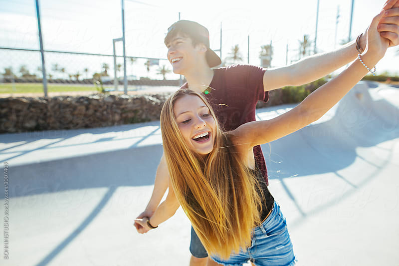 Happy teenage couple having fun on a sunny summer day. by BONNINSTUDIO for Stocksy United