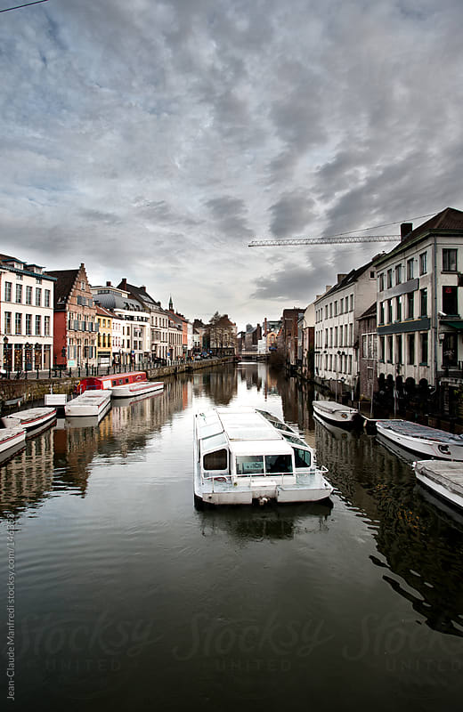 Tourist boat in a canal of Gent, Flemish town in Belgium by Jean-Claude Manfredi for Stocksy United