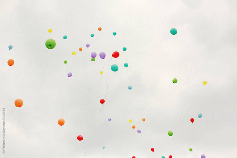 Balloons floating to sky by Jeff Marsh for Stocksy United