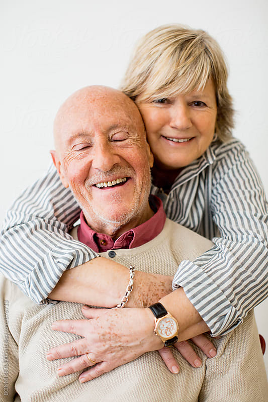 Elderly couple in love smiling together on white. by BONNINSTUDIO for Stocksy United