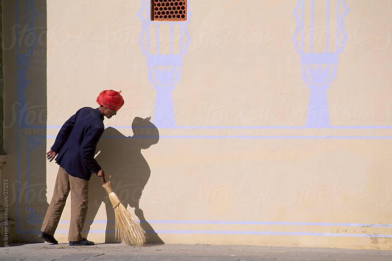 Palace Guard keeping the palace tidy. Jaipur. India by Hugh Sitton for Stocksy United