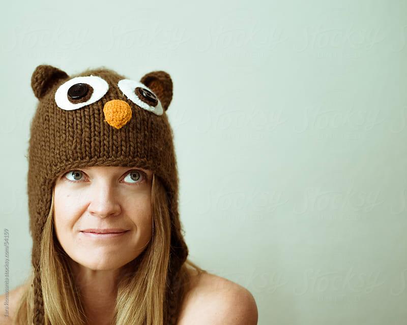 woman wearing an owl winter hat by Tara Romasanta for Stocksy United