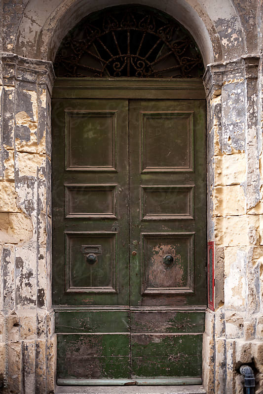 Old door in the city of Valletta by MEM Studio for Stocksy United