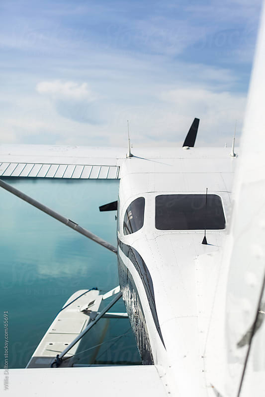 A Sea Plane on a Turquoise Lake by Willie Dalton for Stocksy United