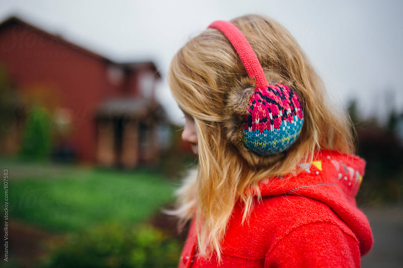 Profile of A little Girl in Earmuffs by Amanda Voelker for Stocksy United
