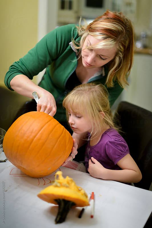 Little Girl and Mother Halloween Pumpkin Carving by JP Danko for Stocksy United