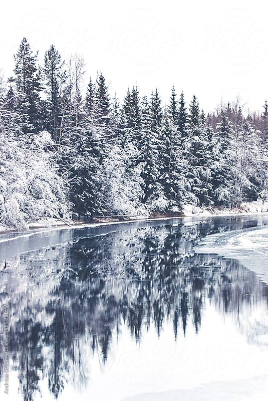 calm winter river  by Andreas Gradin for Stocksy United