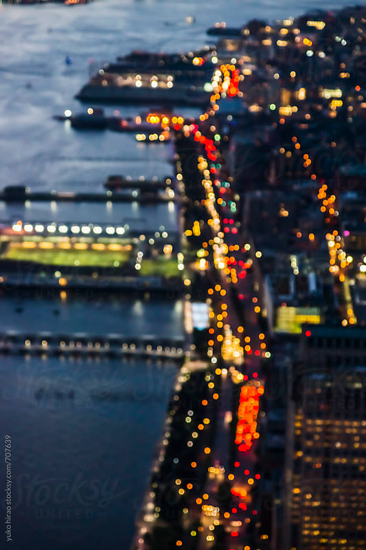 Manhattan at night with crowded traffic lights and illuminations in blur by yuko hirao for Stocksy United