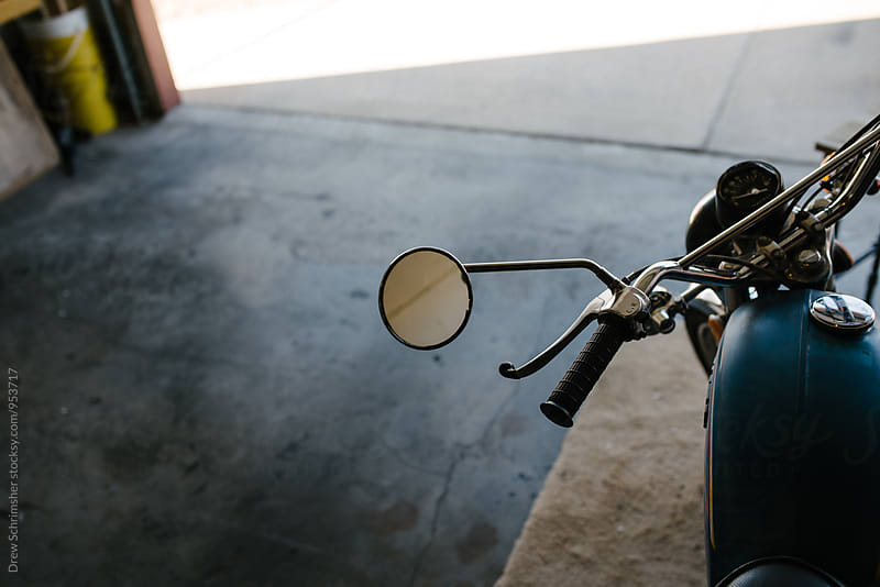 Vintage motorcycle mirror  by Drew Schrimsher for Stocksy United