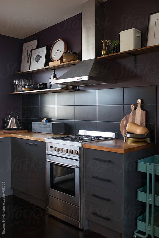 Kitchen interior with dark stying by Rowena Naylor for Stocksy United