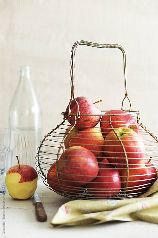 Apple in bucket by Veronika Studer for Stocksy United