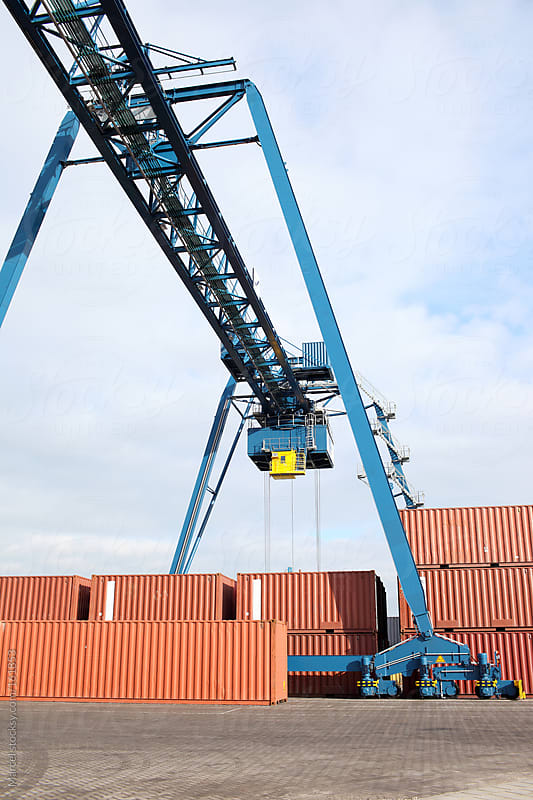 Bridge crane to move containers around by Marcel for Stocksy United