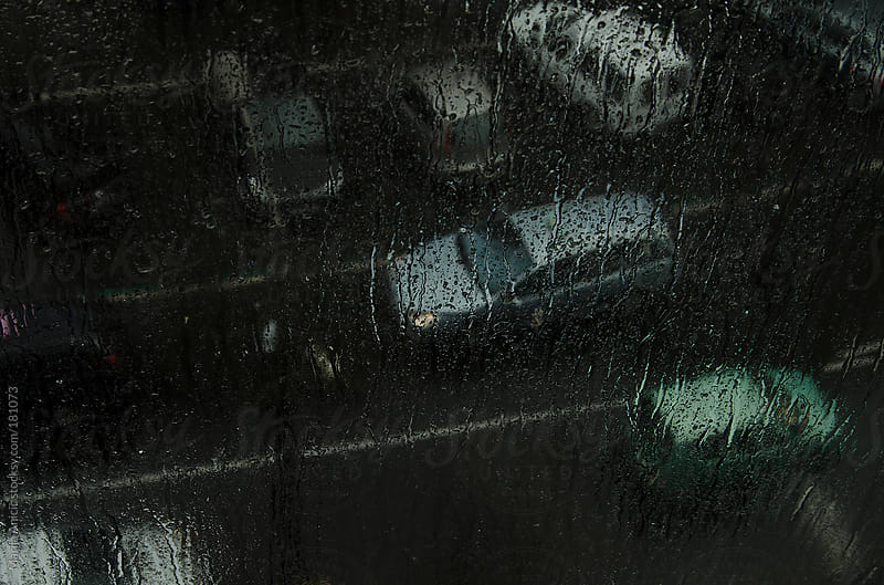 Rainy ,gloomy day trough the wet window by Marija Anicic for Stocksy United
