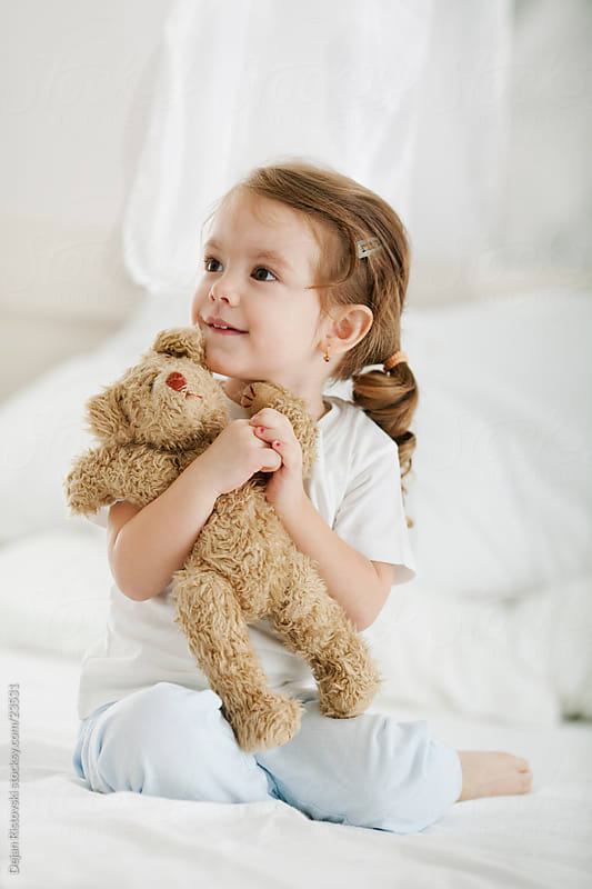 Little girl and bear by Dejan Ristovski for Stocksy United
