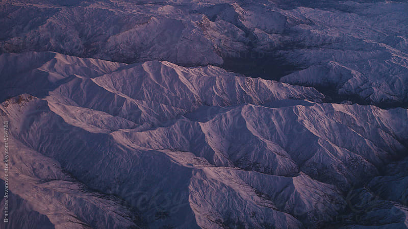 Aerial view of the mountain range by Branislav Jovanović for Stocksy United