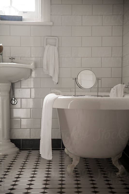 Cast iron claw foot bath in historic bathroom by Ben Ryan for Stocksy United