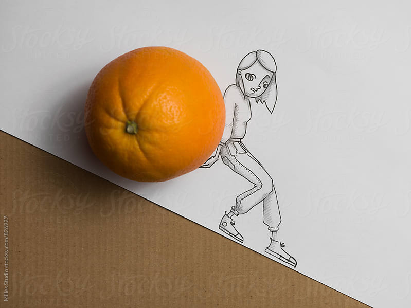 Woman Pulling Orange by Milles Studio for Stocksy United